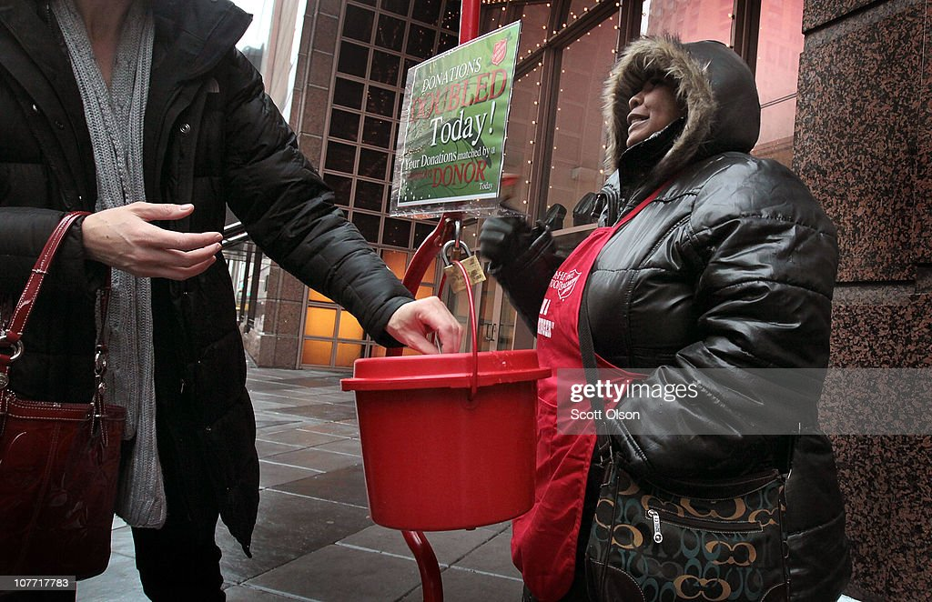 Antionette Levi solicits donations for the Salvation Army December 21 2010 in Chicago Illinois As the season winds down donations to Chicago area...