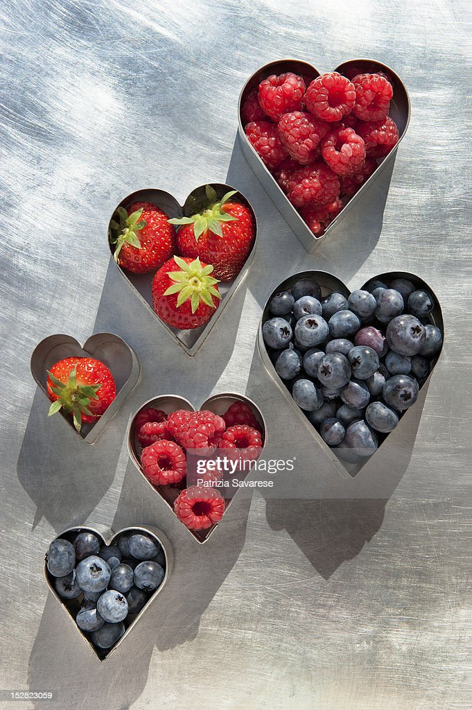 Antioxidant-rich berries in heart-shapes : Stock Photo