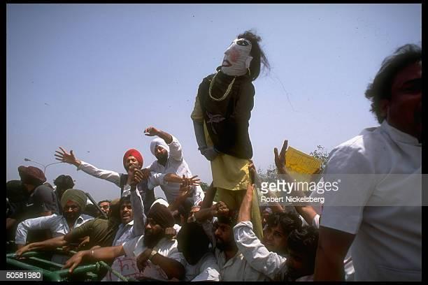 AntiPakistan demonstrators w effigy of PM Benazir Bhutto protesting Pakistan's interference in Kashmir nr Pakistani Embassy