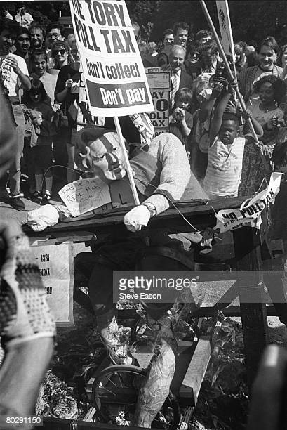 Antipoll tax campaign directed against Prime Minister Margaret Thatcher an effigy of whom is being pilloried 27th May 1990 A placard reads 'The Tory...
