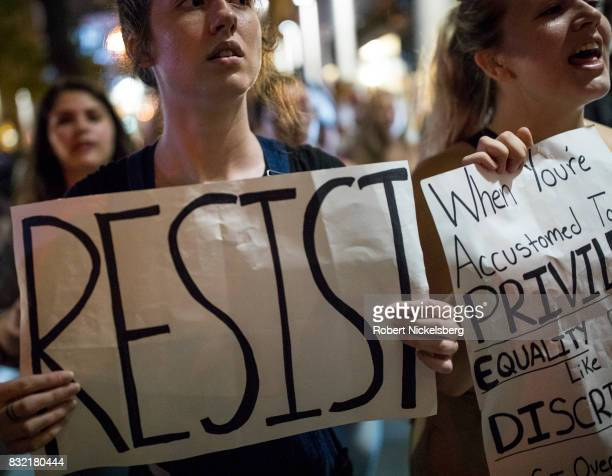 AntiPresident Donald Trump protesters carry signs outside of Trump Tower August 14 2017 in New York City Security throughout the area is high as...
