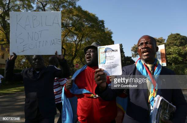 AntiPresident Kabila protestors shout slogans and wave placards as they demonstrate near the entrance to Sefako Makgatho Presidential Guest House in...