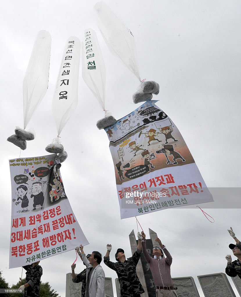 Anti-Pyongyang activists, including North Korean defectors in Seoul, float giant balloons carrying leaflets criticising North Korean leader Kim Jong-Un from Imjingak park near the North-South border in Paju on September 9, 2012. South Korean activists launched across the border balloons carrying leaflets that criticise North Korea's ruling Kim family on the 64th anniversary of the establishment of the North's communist government.
