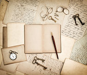 Antique accessories, old letters, pocket watch and keys. Vintage nostalgic background. Retro style toned picture