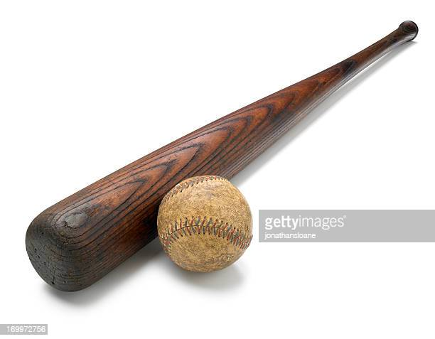 Antique bat and baseball isolated on white background
