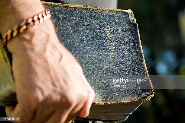 Antique Bible in Hand