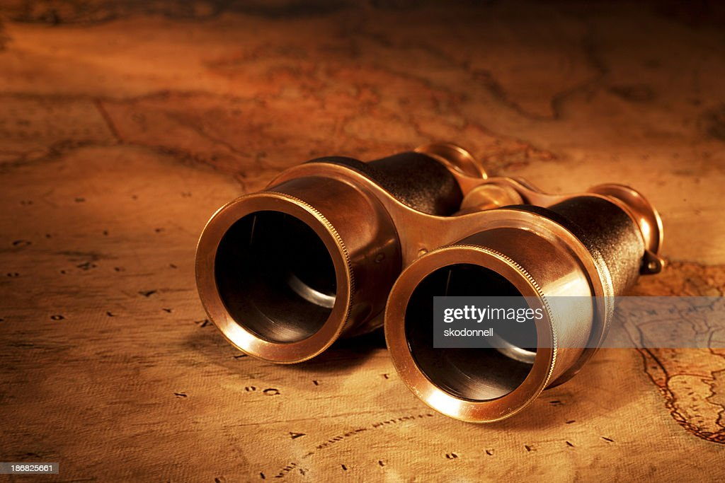 Antique Binoculars on a Old World Map : Stock Photo