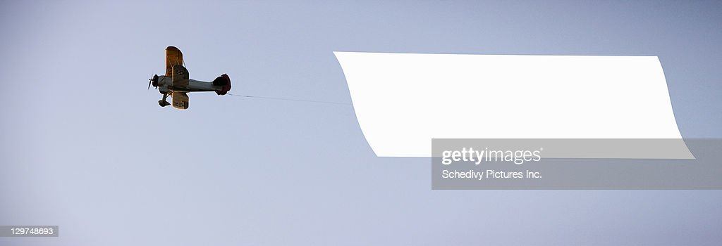 Antique biplane tows blank banner : Stock Photo