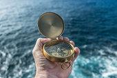 Antique brass compas and ocean