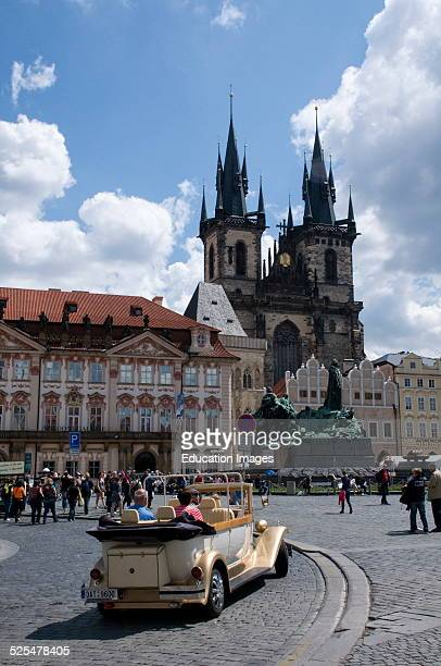 Antique car takes tourist through Pragues Old Town Square Prague Czech Republic