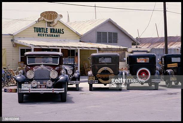 Antique cars portray a bygone era in Key West Florida in August 1987 Actually the old cars are waiting to be used in a scene for a movie about...
