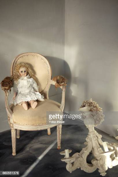 Antique chair and doll