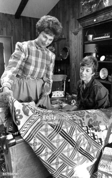 NOV 14 1983 NOV 16 1983 'Antique Collectors' Mrs Janice Johns Showing a Antique Coverlet Made in 1850 selling for $20000 the lady on the right is Mrs...