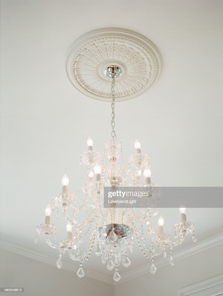 Antique Crystal And White Chandelier With Ceiling Medallion : Stock Photo