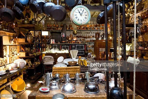 Antique dealer Francois Bachelier's store is specialised in antique kitchen ustensils in SaintOuen flea market on April 25 outside Paris France...
