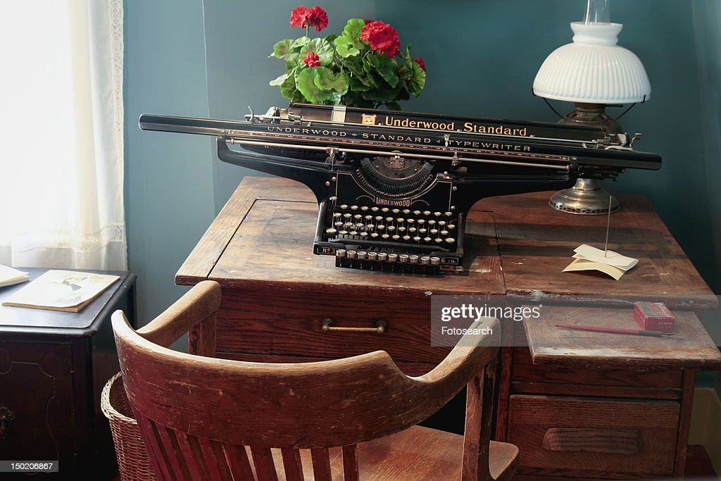 Antique desk and typewriter : Stock Photo - Antique Desk And Typewriter Stock Photo Getty Images