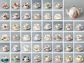 Antique English teapot on the background of many antique bone china teacups.