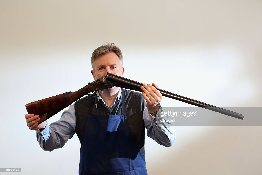 Antique firearms expert Gavin Gardiner poses with a 12-bore 'Russian Purdey' which is due to be auctioned on April 17, 2013 in the 'Fine Modern and Vintage Sporting Guns and Rifles' sale at Sotheby's, on April 15, 2013 in London, England. The gun was presented to British Prime Minister Harold Macmillan by Russian President Nikita Krushchev during MacMillan's historic 1959 State Visit to Russia, it is expected to fetch 30,000 GBP.