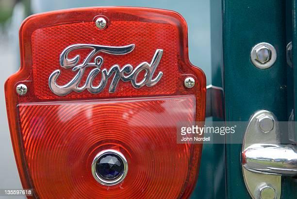 Antique ford car brake light with logo