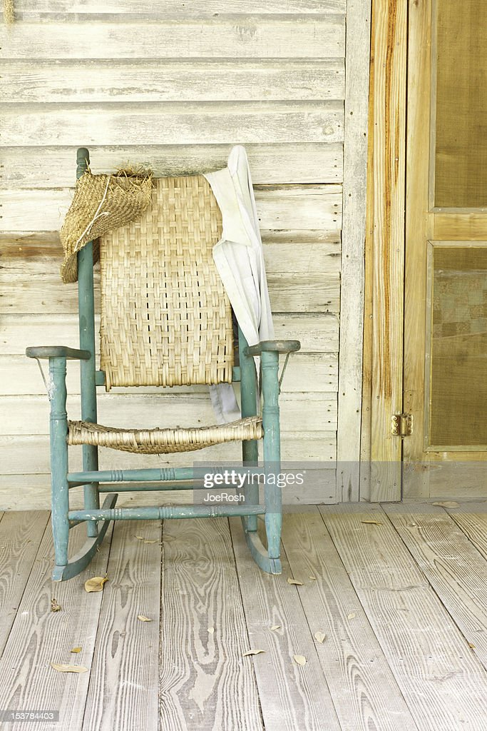 Antique Green Rocking Chair On Rustic Farm Porch