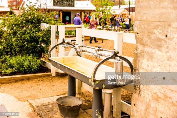WACO, TX, USA  MARCH 18, 2017: Antique hand washing trough outside of the Garden section of Magnolia Market at the Silos.