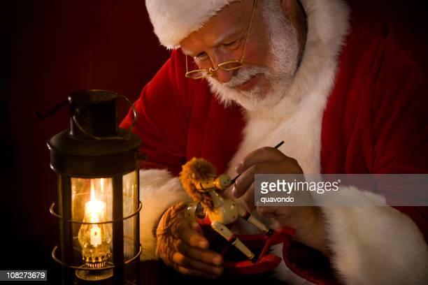 Antique Image de Santa Claus peinture petite par une lanterne