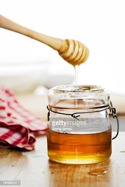 Antique Jar of Honey and Dipper with Copy Space