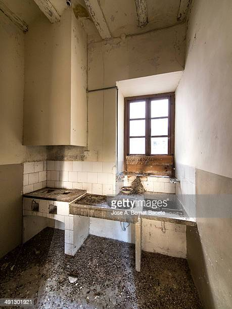 Antique kitchen with laundry and granite sink