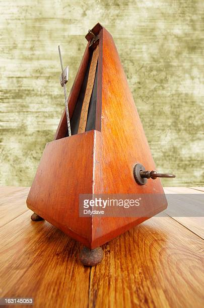 Antique Metronome On Wooden Surface