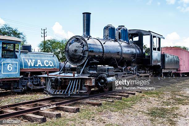 Antique Old Black and Blue Steam Engines and Wheels on Rusty Train Tracks at the Hawaiian Railroad Society Depot and Yard in Ewa Hawaii on the Island...