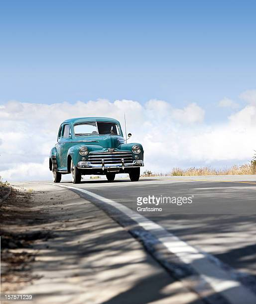 Antique oldtimer car driving in Patagonia Argentina