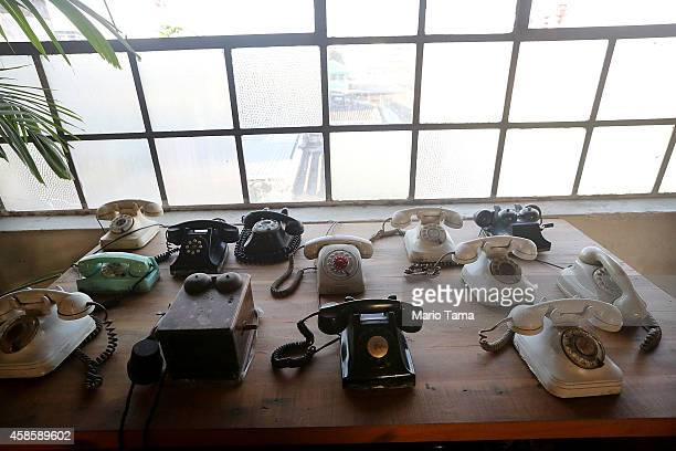 Antique phones are displayed in Fabrica Behring a former German chocolate factory which has become an art collective during Design Week festivities...