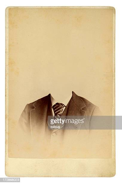 Antique photo of man in gradually fading suit with no head