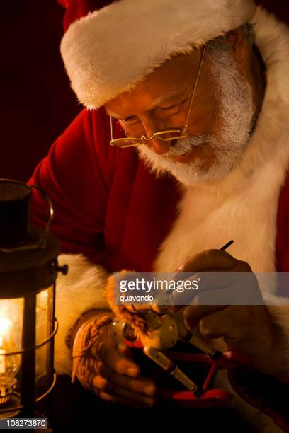 Antique Photo of Santa Claus Painting a Toy by Lantern