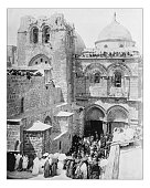 Antique photograph of crowd outside the Church of the Holy Sepulchre (Jerusalem, Israel) in a 19th century picture depicting many people entering in the church (that according to the legend is built o