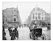 Antique photograph of Seven Dials junction in London as it was in the late 19th century. It is a small circular square, a road junction of seven streets in Covent Garden in the West End of London. In