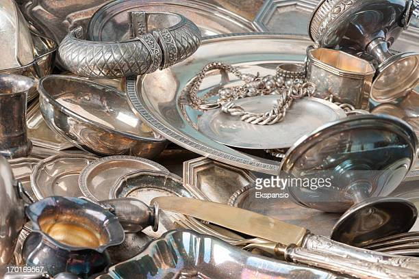 Antique Silverware and Old Silver Jewelry Background