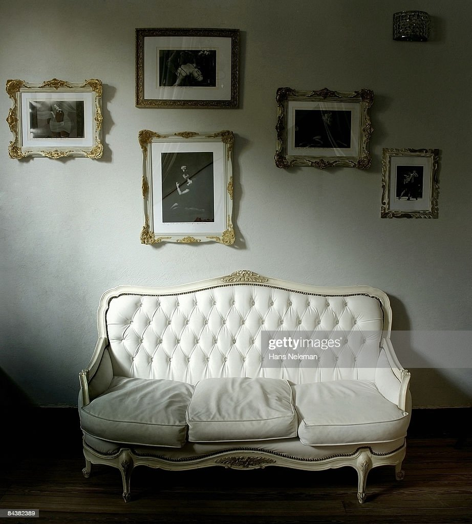 Antique sofa with pictures of tango dancers  : Stock Photo