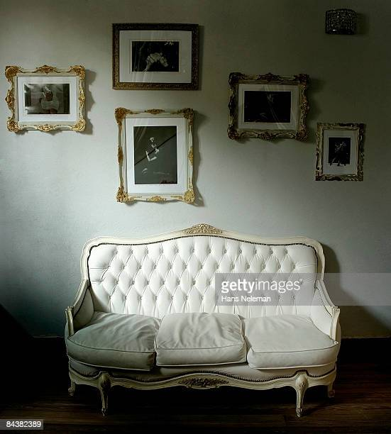 Antique sofa with pictures of tango dancers