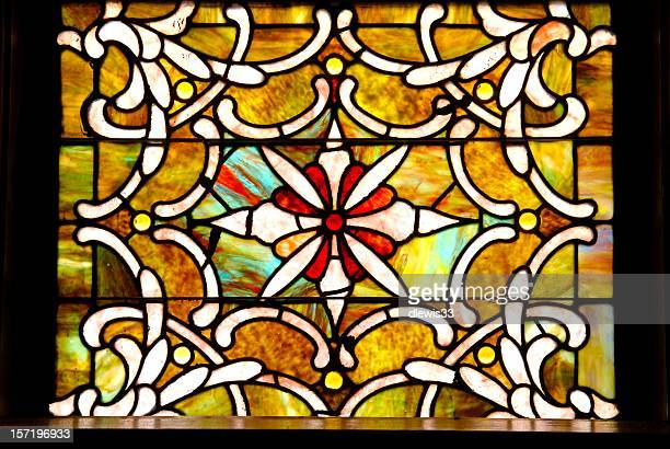 Antique stained glass window in sanctuary
