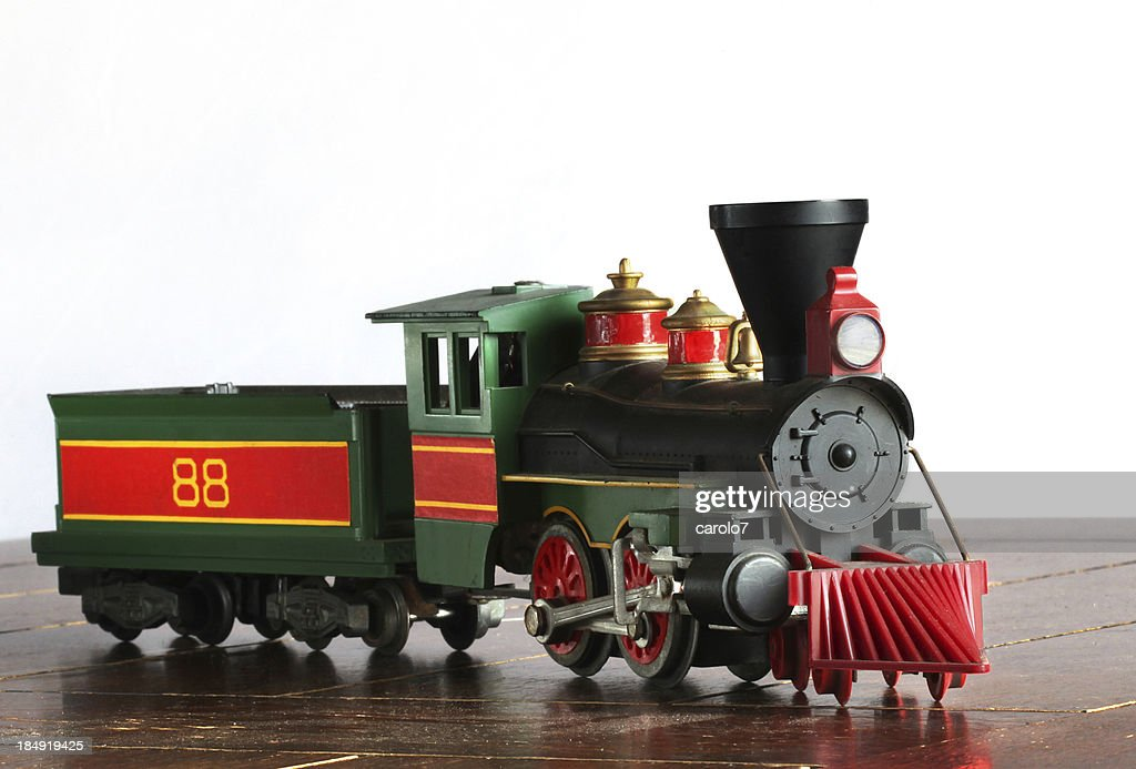 Antique steam engine and coal car.  Model train.  Copy space.