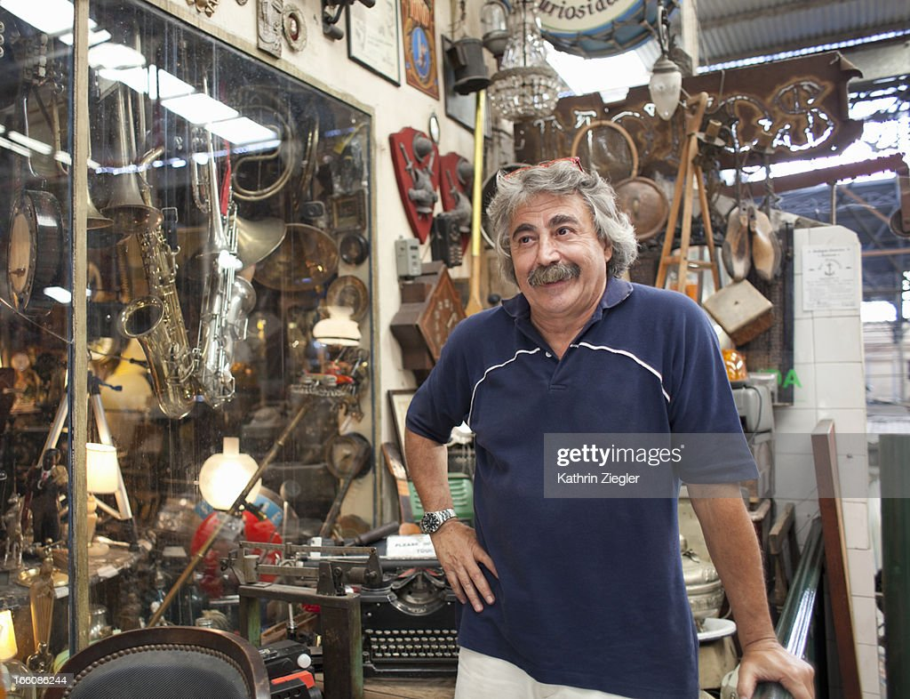antique store owner in front of his shop