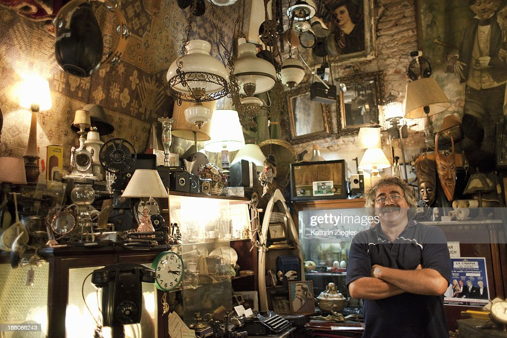 antique store owner in his shop : Stock Photo
