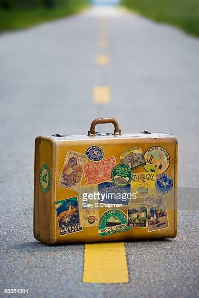 Antique suitcase on road