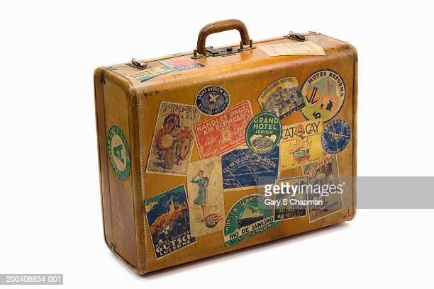 Antique suitcase with decals
