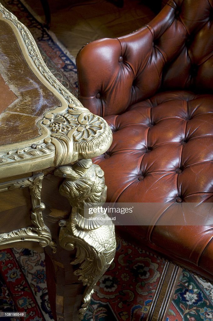 Antique Table and Chesterfield Leather Armchair with Oriental Rug : Stock Photo