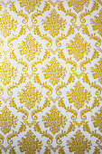 Antique Wallpaper with Gold Floral. Olf Fashion.