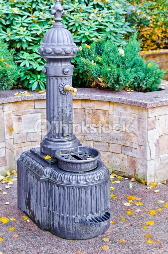 Antique Water Faucet In Garden Stock Photo | Thinkstock