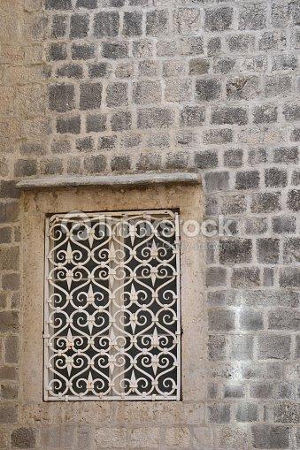 Antique Window With Decorative Metal Grate Stock Photo Thinkstock