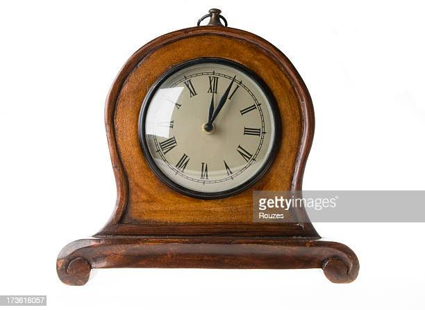 Antique wood frame clock isolated on white background